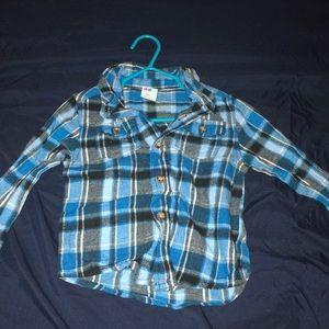 Blue button up shirt, never been worn.